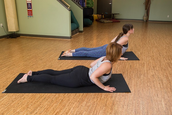 Inner Spring Yoga instructors Carrie Klaus (front) and Lydia Lagenour demonstrate Cobra Pose.