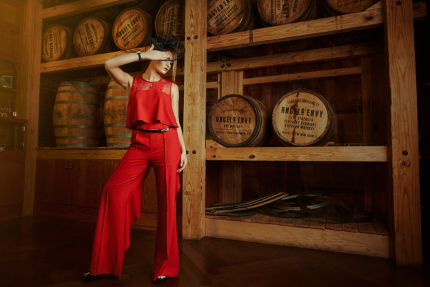 Katya in Strut & Bolt Red Jumpsuit from Sapphire on Spring $64 / Black Fascinator from Ben Franklin $49.99